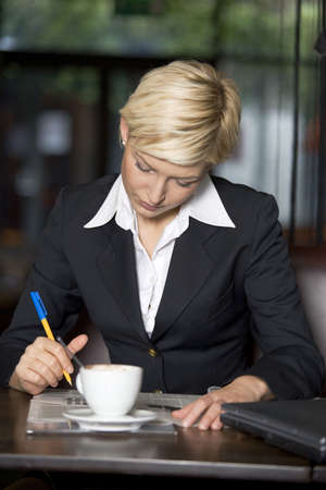 Businesswoman in a restaurant LANG_EVOIMAGES