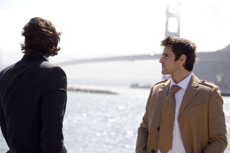 two persons only: Businessmen with Golden Gate Bridge in the background