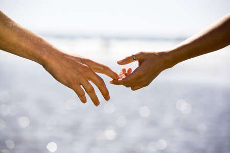 Two people about to hold hands