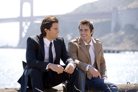 smiing: Businessmen sitting with Golden Gate Bridge in the background