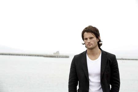 Man posing at the bay Stock Photo - 3194282