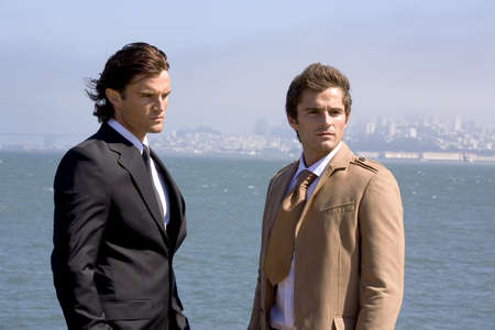Two businessmen looking away LANG_EVOIMAGES