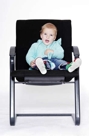 comfy: Boy sitting on an office chair.
