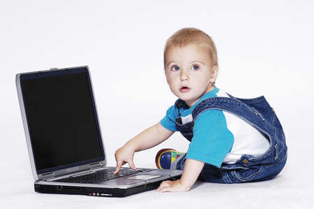 Boy playing with laptop.