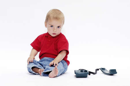 Boy playing with telephone.