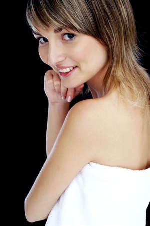 Woman in towel smiling at the camera. Stock Photo - 3192120