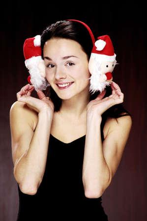 Woman wearing cute earmuffs. Stock Photo - 3192167