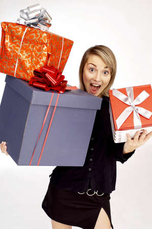 Portrait of woman holding gifts. Stock Photo - 3192168