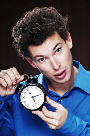 Man trying to listen to his alarm clock. Stock Photo - 3192173