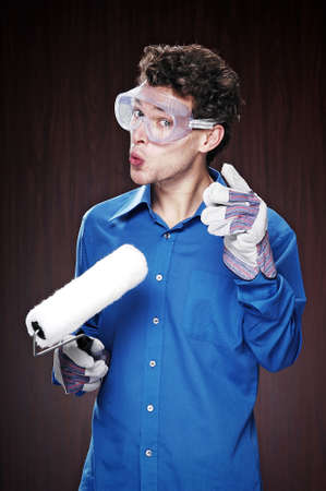 Man with goggles holding a paint roller. Stock Photo - 3192183