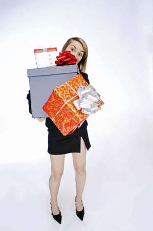 Portrait of woman carrying gifts. Stock Photo - 3192185