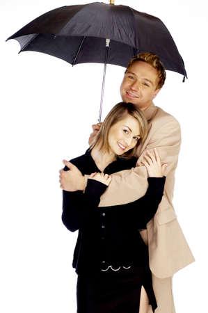 Loving couple sharing an umbrella. Stock Photo - 3192188