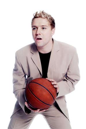 Businessman playing basketball. Stock Photo - 3192194