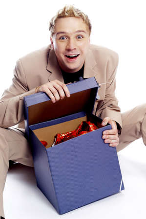 Man opening his present anxiously. Stock Photo - 3192207