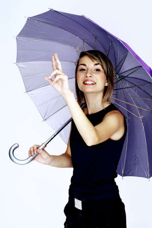 Woman holding an umbrella. Stock Photo - 3192208