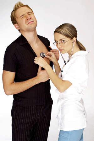 stethoscope: Female doctor treating her patient.