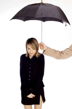 hand: Mans hand shading woman with an umbrella. LANG_EVOIMAGES