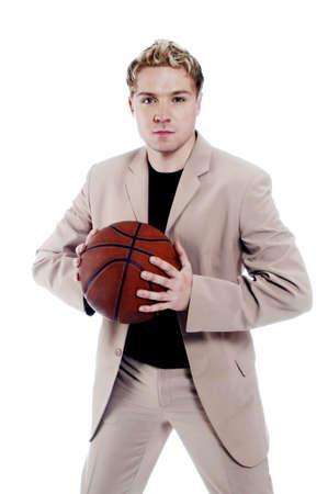 Businessman holding a basketball. Stock Photo - 3192225