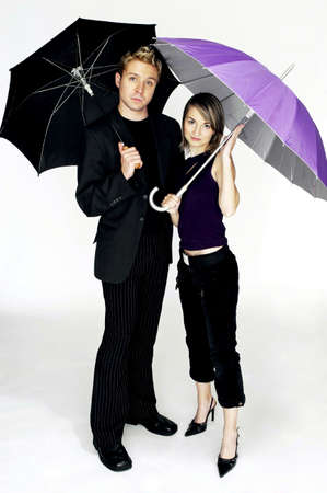 Couple holding umbrellas. Stock Photo - 3192231