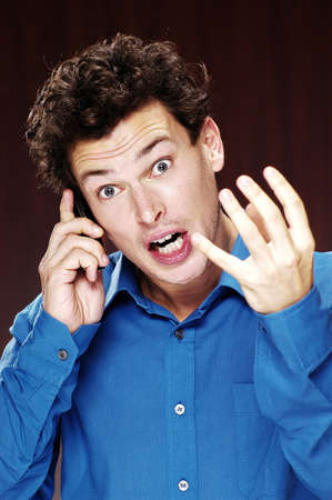 Man talking angrily into his mobile phone. Stock Photo - 3192245