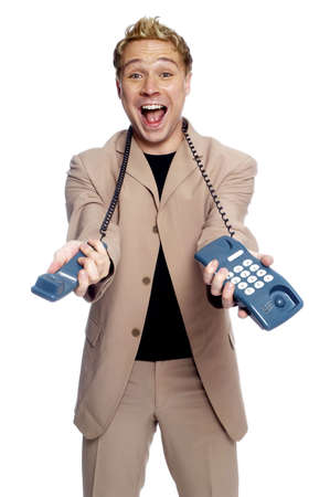 telephone: Businessman holding a telephone.