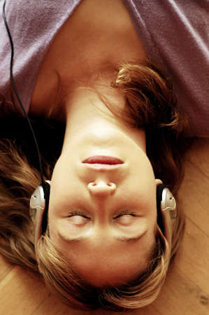 Woman listening to music on the headphones.