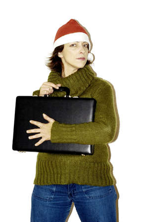 Woman in christmas hat holding tightly to her briefcase.