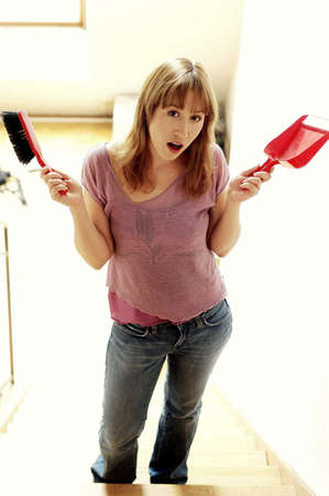 Woman holding brush and dustpan. Stock Photo - 3192283
