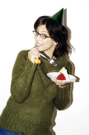 Woman eating cake. Stock Photo - 3192290