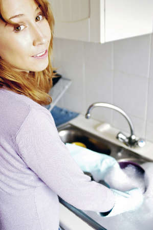 Woman washing dishes. Stock Photo - 3192307