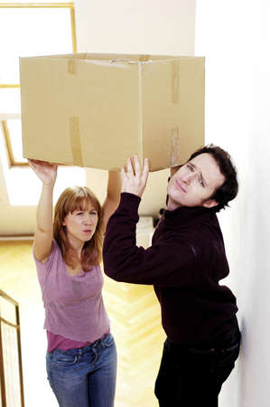 second floor: Couple carrying box to the second floor.