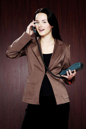 Businesswoman answering call. Stock Photo - 3192348
