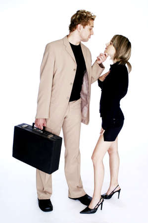 Businessman taking a closer look at his secretary. Stock Photo - 3192356