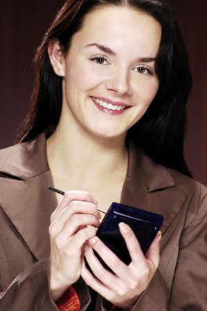 Businesswoman using PDA. Stock Photo - 3192371