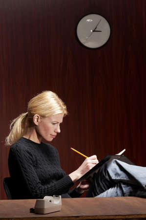 Businesswoman busy writing report. Stock Photo - 3192374
