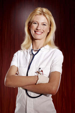 Female doctor flashing a smile at the camera. Stock Photo - 3192398