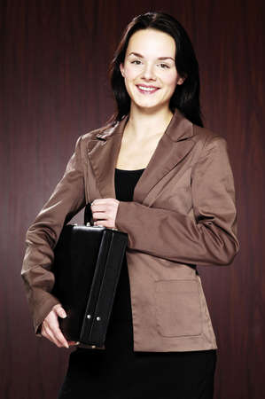 Businesswoman holding a briefcase. Stock Photo - 3192419