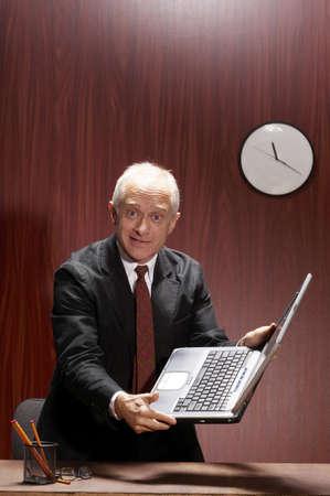 Businessman holding a laptop. Stock Photo - 3192430