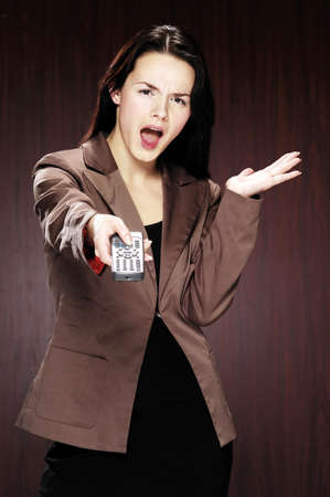 Businesswoman pointing a remote control at the camera. Stock Photo - 3192440