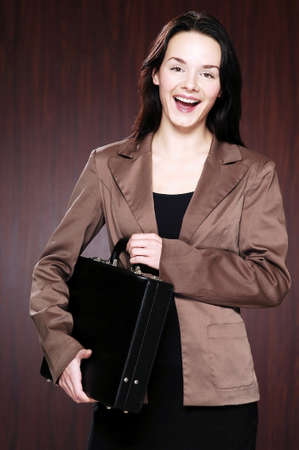 Businesswoman holding a briefcase. Stock Photo - 3192442