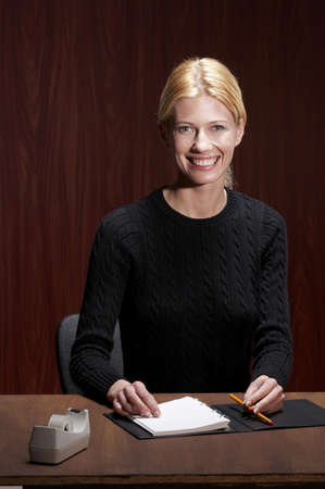 Businesswoman flashing a smile at the camera. Stock Photo - 3192443