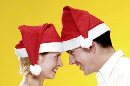 Couple in christmas hats. Stock Photo - 3192456