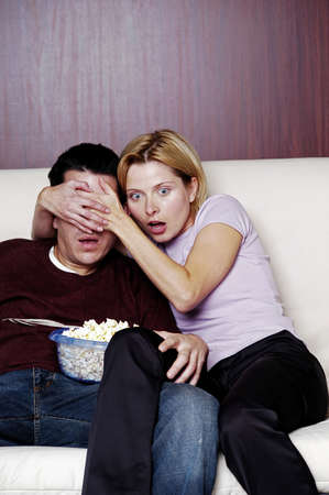 protect: Couple watching horror movie. LANG_EVOIMAGES