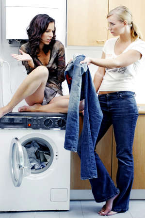 laundry room: Women doing laundry. LANG_EVOIMAGES