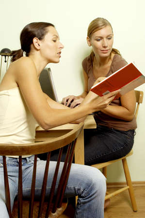room mate: Women doing group assignment.