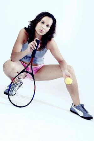 cuclillas: Jugador de tenis femenino.