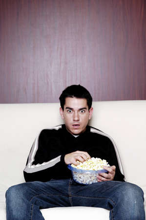 Man eating popcorn while watching movie. Stock Photo - 3192477