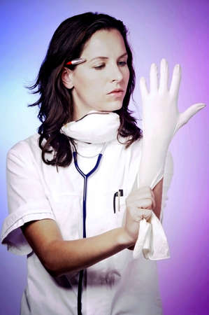 Female doctor putting on gloves. Stock Photo - 3192488