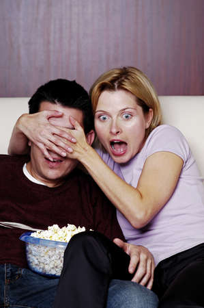 holiday movies: Couple watching horror movie. LANG_EVOIMAGES