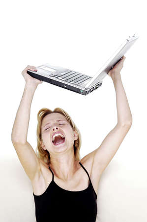 throw up: Angry woman about to throw her laptop. LANG_EVOIMAGES